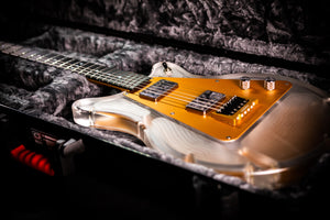 Aluminati Guitar Company Custom Shop Guitar Anodized Aluminum in Gold with Aluminum Guitar Neck and Lucite or Acrylic and Aluminum Guitar Body. Featuring an AlumiCrown Aluminum Guitar Bridge. Aluminati Guitar Company makes Aluminum Guitar Necks in the USA