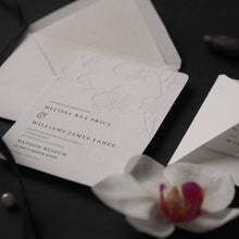 43. Royal Embossed Orchids Destination Wedding Invitation