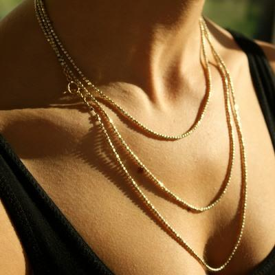 Long Gold Bead necklace can be worn 3 different lengths