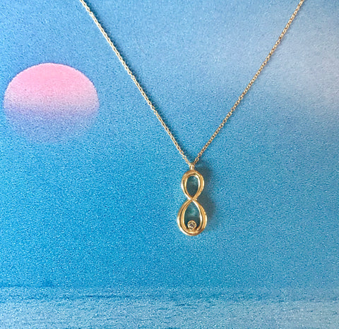 Yellow gold and Diamond Infinity Necklace