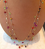 Double strand of Multi colored Gem stones and 18 kt yellow gold chains