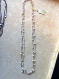 Mini pearl and white gold 3 strand necklace.