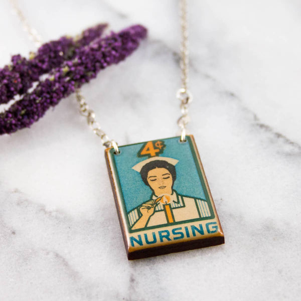 VINTAGE NURSING POSTAGE STAMP NECKLACE