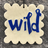 HAND CARVED CERAMIC WORD ORNAMENT - WILD