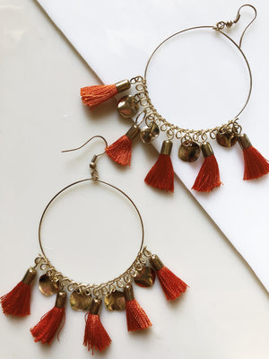 orange tassel hoop earrings