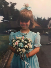 Image of me as a flower girl in the 80s with a big blue hair bow