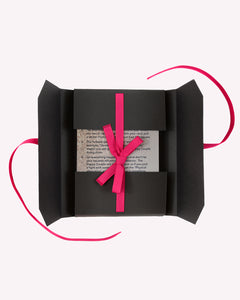 Open Wedding Bingo charcoal game package with a hot pink ribbon