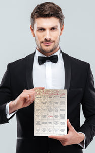 Groom holding a rose gold glitter Wedding Bingo card