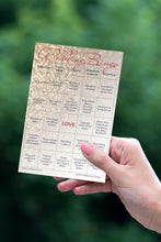 Woman's hand holding a rose gold glitter Wedding Bingo card