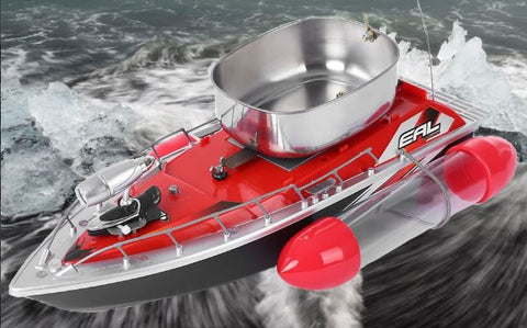 Red RC fishing boat with chum tray on top to attract more fish while on the water with side stabilizers