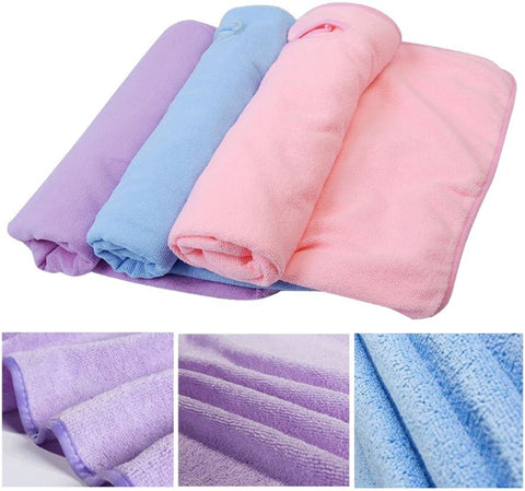 pink, blue and purple towels