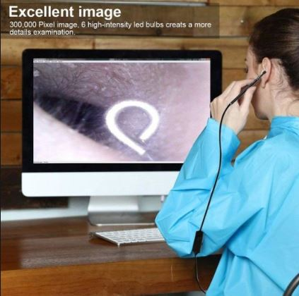 Girl using micro ear cleaning camera for removing ear wax and observing inside ears