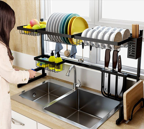 Woman organizing her Over the sink drip dry kitchenware organizer and counter space optimizer