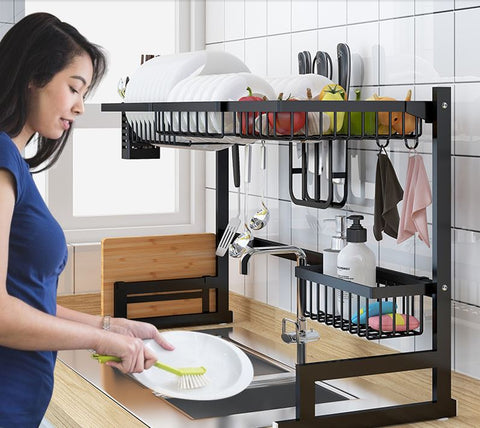 Woman cleaning dishes while using the Over the sink drip dry kitchenware organizer and counter space optimizer