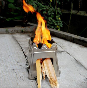 small wood burning portable camping survival stove burning wooden sticks and has a big fire flame