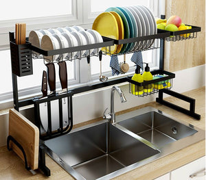 Close up Over the sink drip dry kitchenware organizer and counter space optimizer with dishes