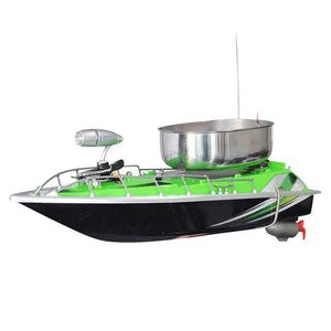 Green RC fishing boat with chum tray on top to attract more fish