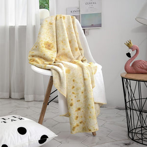 Real looking burrito blanket on a chair that looks like a tortilla shell taco