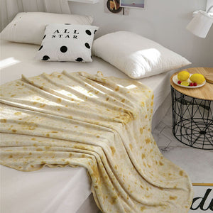 Real looking burrito blanket on a bed that looks like a tortilla shell taco