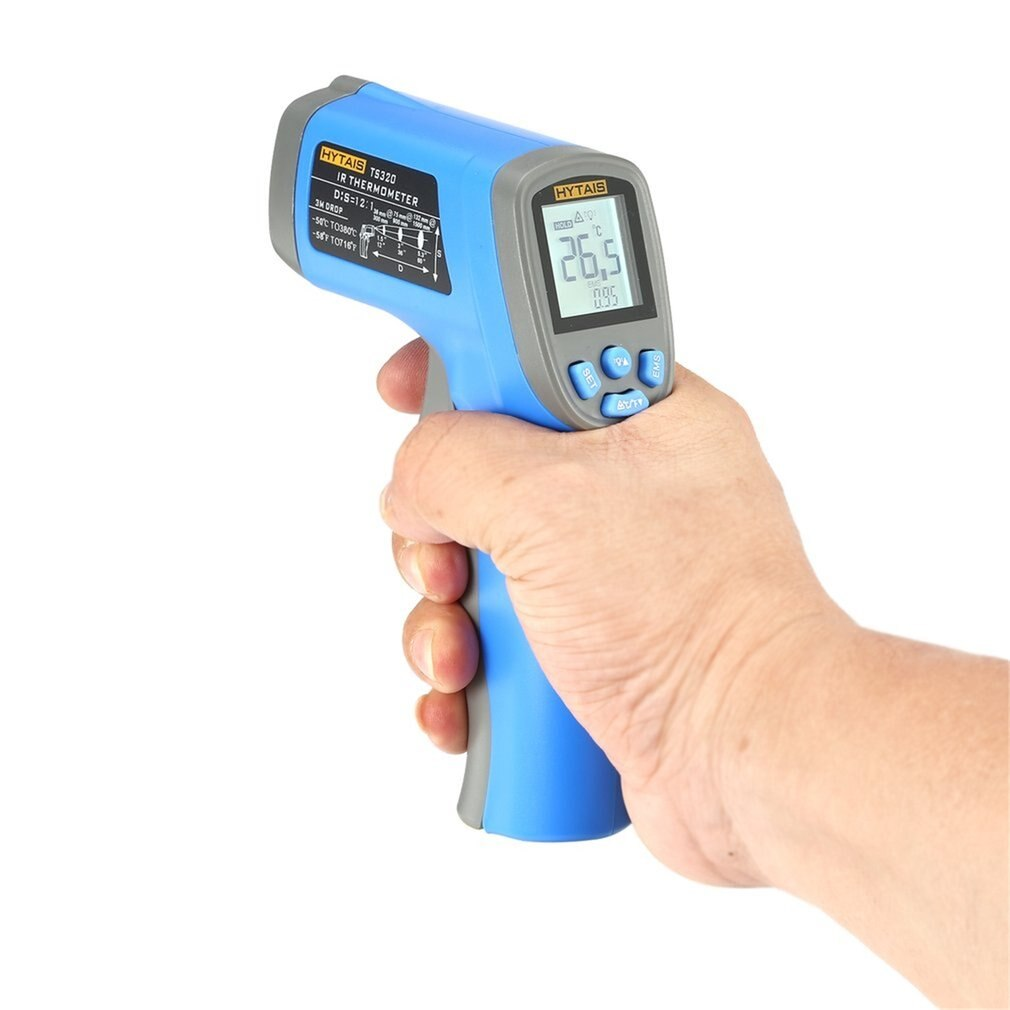 Laser thermometer digital gun held in hand.
