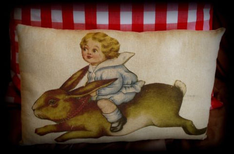 Vintage antique child riding a Easter bunny rabbit hare pillow spring fairytale