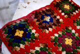 Darling happy and bright tiny grandma's garden knitted table afghan <3