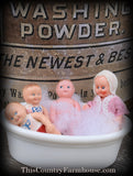 Four darling antique NAKEY babies in milk glass wash tub