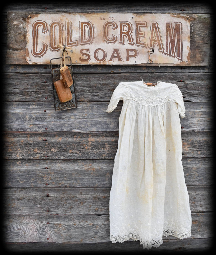 Cold Cream Soap textile rack sign with old dress soap bars and soap grater set vignette