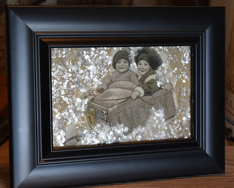 Framed children on sled Ivory Soap box mica snow