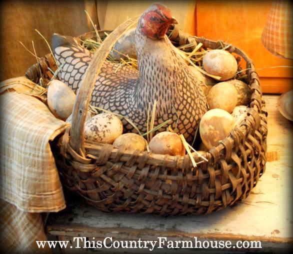 Black and white hen in kitchen basket