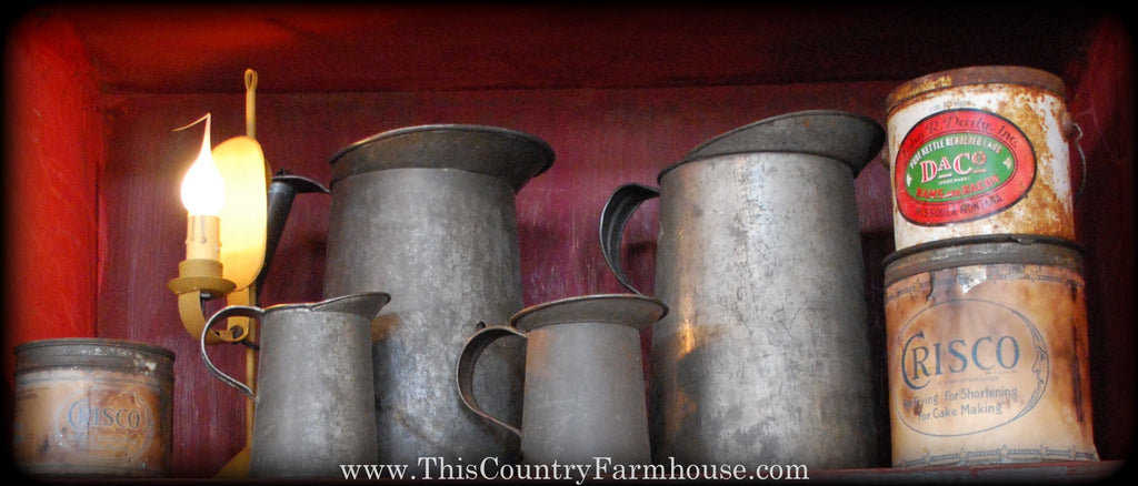 Old tin pitchers