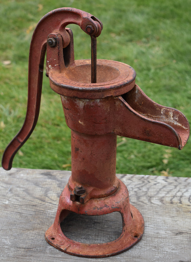 Red old primitive water pump Just in time for Christmas!!