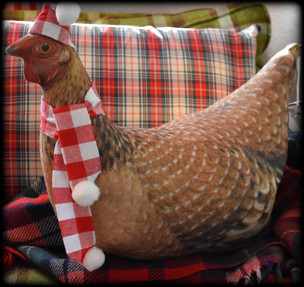 Christmas winter brown hen in Santa hat and scarf
