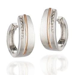 Sterling Silver and rose tone brushed huggie earrings with round CZs on half of one side