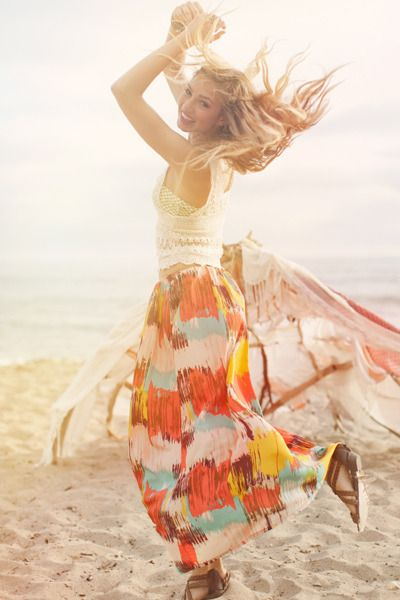 dancing boho girl on the beach