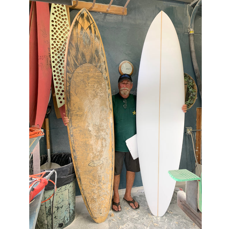 Bill Stewart with hand-shaped surfboard remake of old surfboard