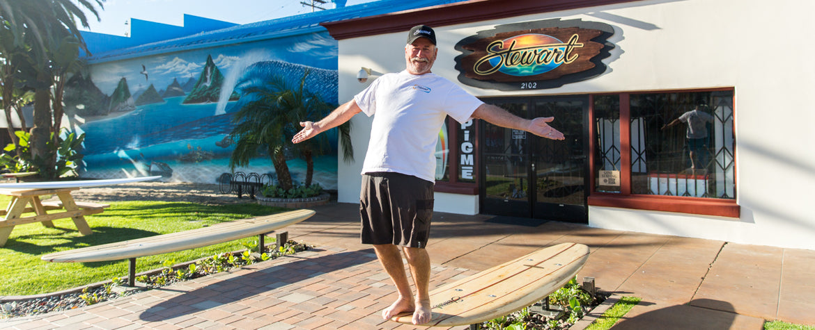 Bill Stewart in front of Stewart Surf Shop