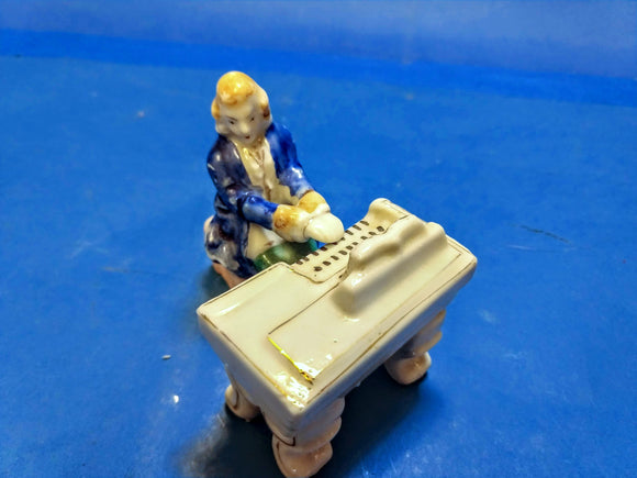Porcelain Piano and Player