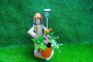 Standing girl with a pot and solar light