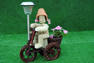 Girl or Boy on a small dark wika bike with solar light