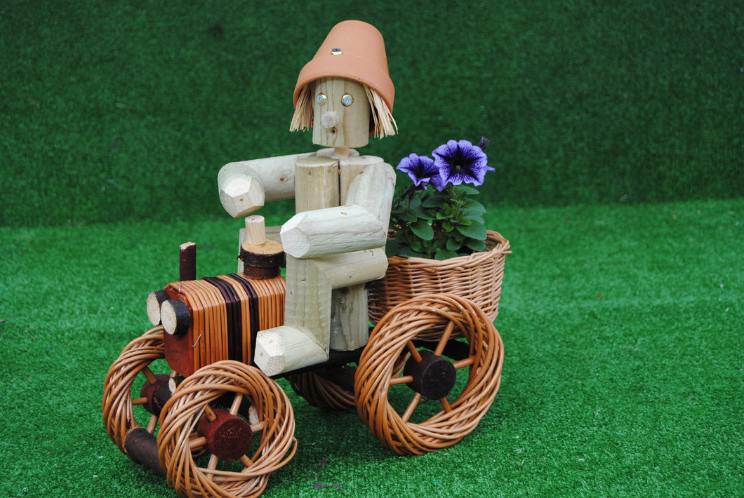 Man on a small bright wicker tractor
