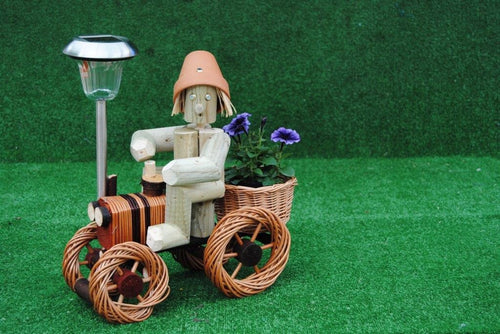 Man on a small bright wika tractor with solar light