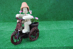 Girl or Boy on a small dark wicker bike