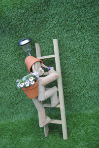 Girl or boy climbing a ladder with a solar lamp