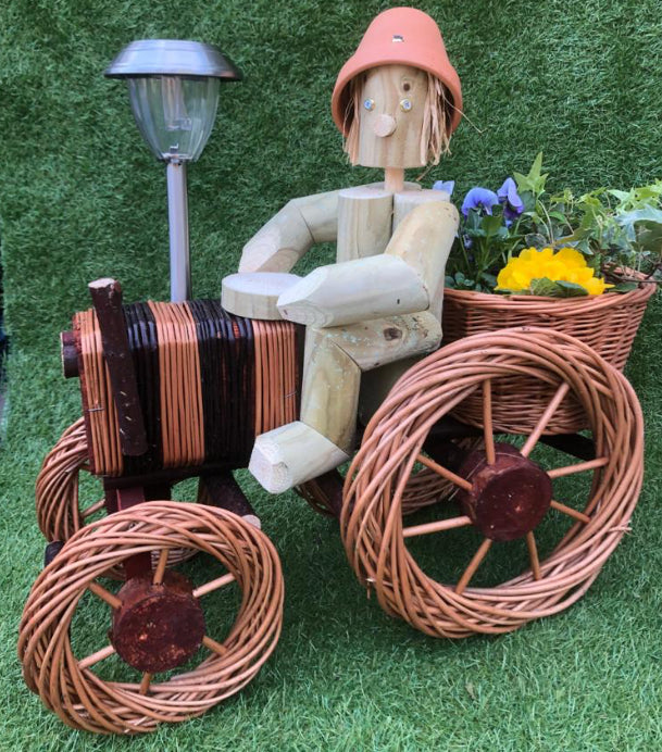 Boy on a bright big wicker tractor with solar light