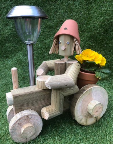 small wooden tractor with solar light
