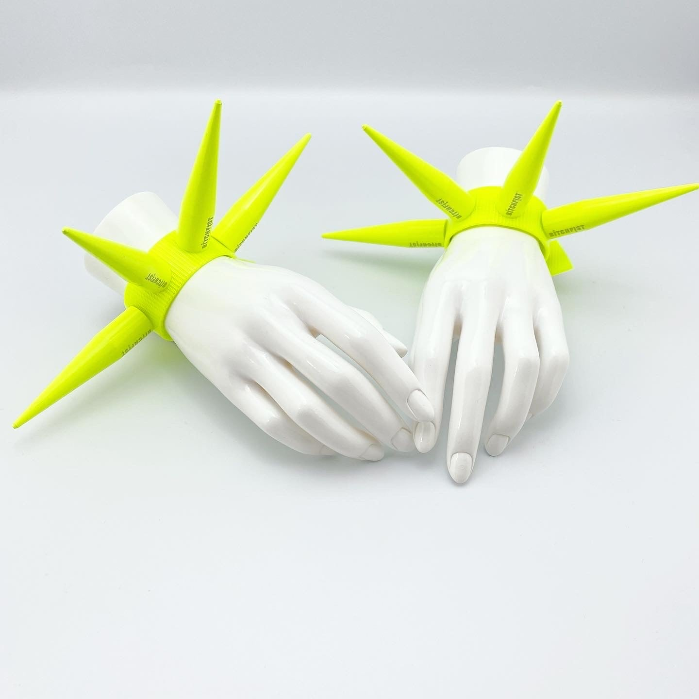 BITCHSPIKE CUFFS IN NEON YELLOW