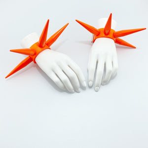 BITCHSPIKE CUFFS IN NEON ORANGE