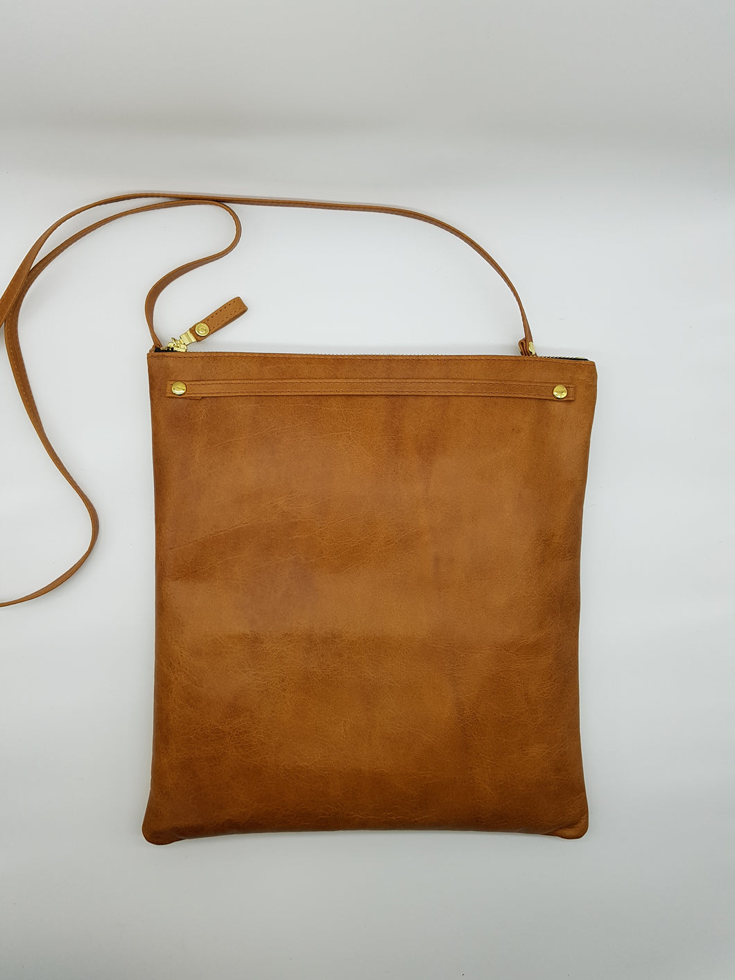 handcrafted cowhide leather cross body bag which fits ipad and tablet