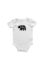 "White short sleeve bodysuit with a bear on it.  The word ""baby"" is inscribed inside the bear."